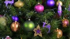 Christmas Tree with jewel color decorations with twinkling lights, static. Stock Footage