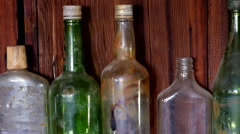 Zoom Out - Old Bottles on wall in Abandon Riley's Camp - Mojave Desert Stock Footage