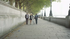 4K Smiling London business people chatting as they walk through the city Stock Footage