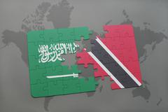 Puzzle with the national flag of saudi arabia and trinidad and tobago on a wo Stock Photos