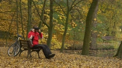 Man in 360Vr Headset Turning Head Sits on Bench in Park Gets up Watching Video Stock Footage