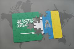 Puzzle with the national flag of saudi arabia and canary islands on a world m Stock Photos