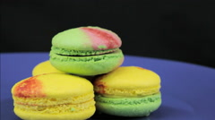 Yellow and green macaroon rotate on a dark background Stock Footage