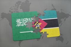 Puzzle with the national flag of saudi arabia and mozambique on a world map b Stock Photos