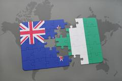 Puzzle with the national flag of new zealand and nigeria on a world map backg Kuvituskuvat