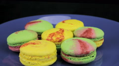 Yellow and green macaroon on a plate Stock Footage