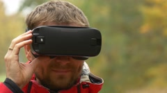 Man Watching Video 360 Degrees in 360Vr Glasses Outdoors Playing Virtual Games Stock Footage