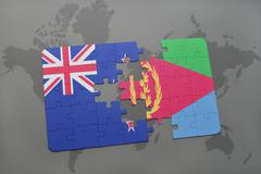 Puzzle with the national flag of new zealand and eritrea on a world map backg Stock Photos