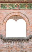 Mullioned medieval window suitable as a frame. Stock Photos