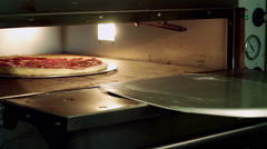 Cooking pizza. Baking pizza in the oven. Close-up shot. HD Stock Footage