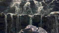 Mountain waterfall. Close up of water falling over stones in slow motion Stock Footage