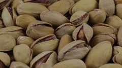 Dried roasted salted appetizing pistachios rotating, close up Stock Footage