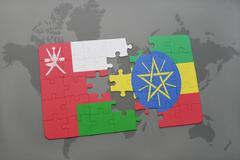 Puzzle with the national flag of oman and ethiopia on a world map background. Stock Illustration