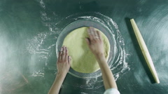 Cooking pizza. Female hands kneading dough, preparing a pizza base. Top view. HD Stock Footage