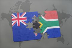 Puzzle with the national flag of new zealand and south africa on a world map  Stock Illustration
