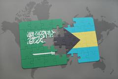 Puzzle with the national flag of saudi arabia and bahamas on a world map back Stock Illustration