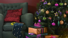 Festive Christmas Scene with comfortable chair beside a Christmas tree Stock Footage