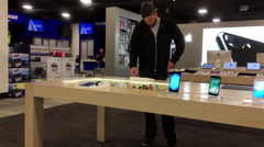 Man trying new iwatch inside Best buy store with 4k resolution Stock Footage
