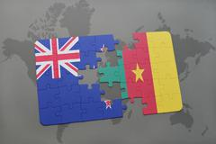 Puzzle with the national flag of new zealand and cameroon on a world map back Piirros