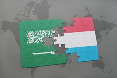 Puzzle with the national flag of saudi arabia and luxembourg on a world map b Stock Illustration