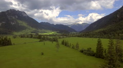 Landscape aerial wide panorama nature green grass pastures valley mountains Stock Footage