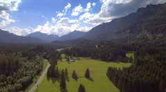 Beautiful aerial forward panorama skyline nature green grass meadow blue sky day Stock Footage