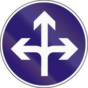 Road sign used in Hungary - Turn left, right or straight ahead Stock Illustration