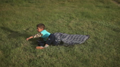 Boy on the grass hugging dog Stock Footage