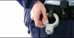 Mid section of security guard holding handcuffs Stock Footage