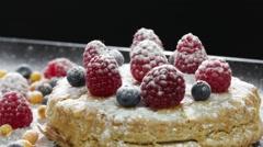 Cake with raspberries, blueberries, sea buckthorn sprinkled with powdered sugar Stock Footage