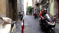 Motorcycle scooters narrow streets, Naples Italy Stock Footage