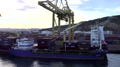 Cargo ship freight containers, port loading dock crane Stock Footage