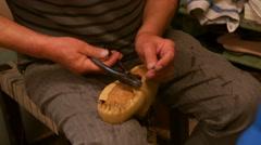 Cobbler repairing a shoe Stock Footage