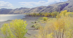 Aerial over peaceful lake and autumn trees at topaz lake Stock Footage