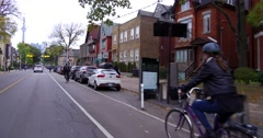 Bike lanes cars and people in downtown Toronto Stock Footage