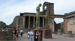 Tourists visit the ancient Roman forum of the ruins of Pompeii. Stock Footage