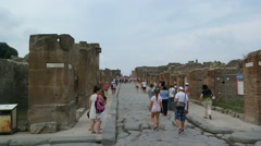 Group of tourists visiting the city of Pompeii. Stock Footage