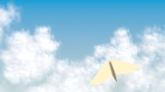 Paper airplane flying through the sky Stock Footage