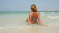 Beautiful woman sits on the seashore, slow motion 3 Stock Footage