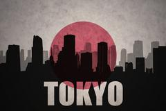 Abstract silhouette of the city with text Tokyo at the vintage japanese flag  Piirros