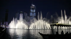 Singing fountain at night in the center of Dubai, UAE Stock Footage