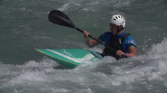 White Water Kayaker skillfully Rides the Rapids. Stock Footage