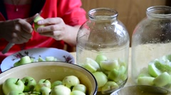 Woman cutting apples for cooking canned compote Stock Footage
