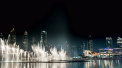 Singing fountain at night in the center of Dubai, UAE. Time lapse Stock Footage