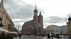 Tourists and citizens on central square of city before Mariatsky church Stock Footage