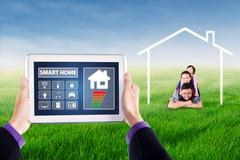 Applications of smart home controller on tablet Stock Photos