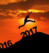 Attractive male leaping above numbers 2017 Stock Illustration