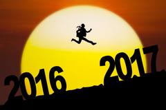 Young entrepreneur leaping between number 2016 to 2017 Stock Illustration
