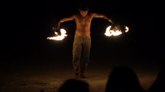Man playing with fire during show on beach, super slow motion 120fps Stock Footage