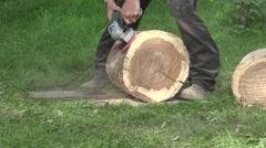 Carpenter uses handheld power sander to smooth sand oak tree bark surface Stock Footage